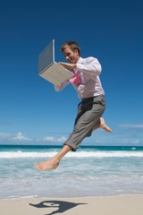 iStock_Joyous-computer-man-on-beach-XSmall
